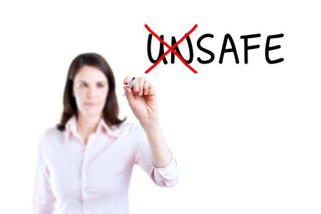Businesswoman Choosing Safe INSTEAD OF Unsafe. Isolated on white.