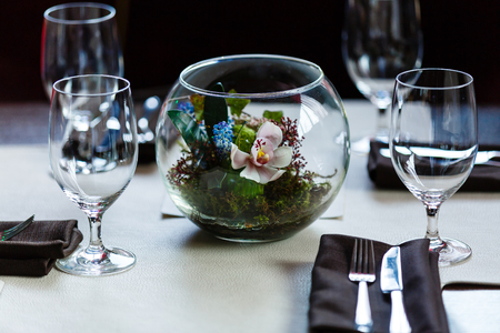 Empty glasses set in restaurant Glasses in the restaurant on the table flowers