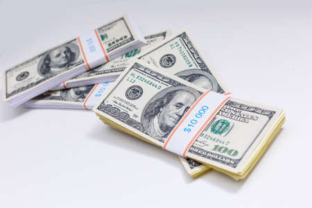 Photo pour Set of a packs of dollars with a rubber band isolated on a white background - image libre de droit