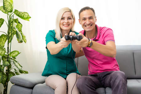 Photo for Couple playing video games at home - Royalty Free Image