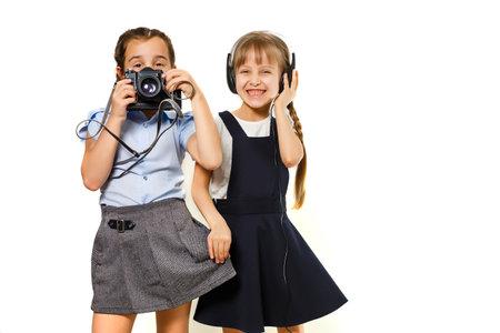 Photo pour Two little schoolgirls. Education, fashion, friendship concept. - image libre de droit