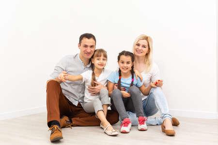 Photo pour Portrait of a happy family smiling at home - image libre de droit