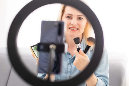 Photo for blogger woman records video with round lamp - Royalty Free Image