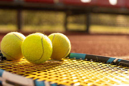 Photo pour Tennis Ball with Racket on the racket in tennis court - image libre de droit