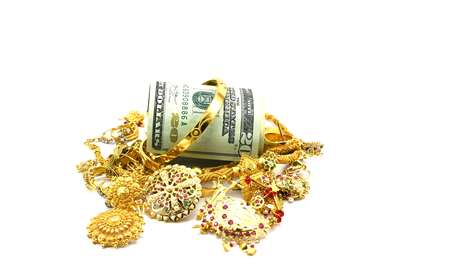 US dollars or Money and Gold Jewelry, Concept of spending money on gold, or rise in price of Gold, or taking loan by pawning gold jewelry