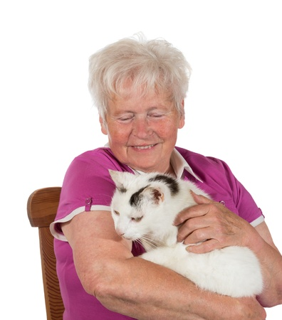 Smiling granny sitting on chair and holding her cat - isolated on white