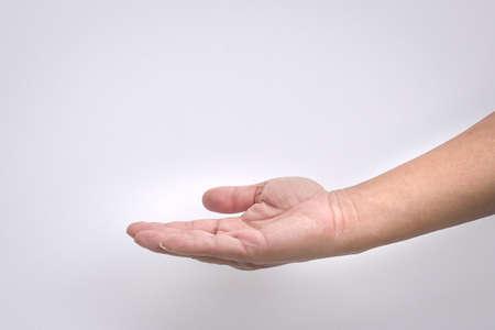 Foto de Open man's hand, palm up isolated on white background. - Imagen libre de derechos
