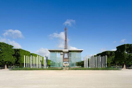 Eiffel tower seen through the Mur de la Paix (Wall for Peace) columns
