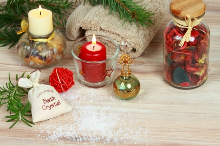 Aromatherapy spa concept with candles. Aromatherapy treatment, rosemary, aromatic herbs, oil, bath crystals on wooden background
