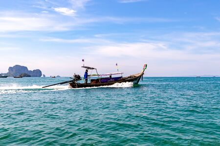 Photo for Krabi Town, Thailand - November 23 2019: Tourists sailing in Longtail Boat in Andaman sea off the coast of Thailand. - Royalty Free Image
