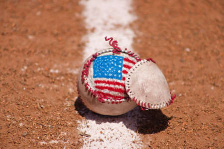 A close up of a torn baseball with a hand painted American Flag.