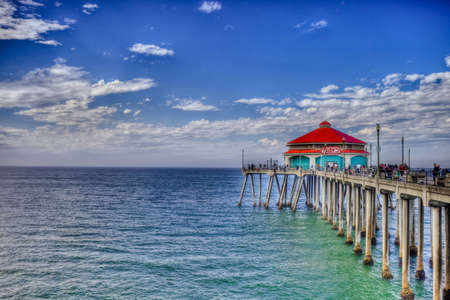 A shot looking down Huntington Beach Pier on a bright sunny labor day.