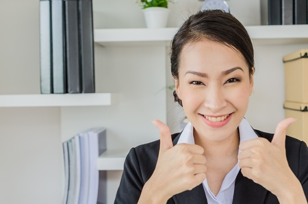Young business women point finger with smiling