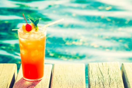 Photo pour Fruit cocktail glass at pool - vintage filter effect - image libre de droit