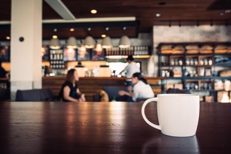 Photo pour Selective focus point on White coffee cup in shop - vintage filter effect - image libre de droit