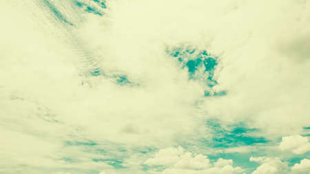 White cloud on blue sky - vintage filter effectの写真素材