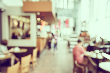 Abstract blur coffee shop background - vintage filter