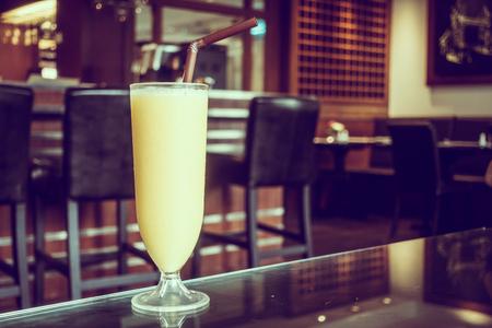 Mango smoothies glass in restaurant - Vintage Filter