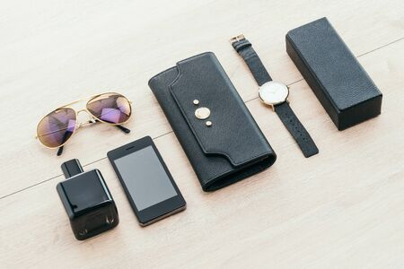 Beautiful accessory with wallet phone glasses watch perfume on wooden background - Vintage light Filter