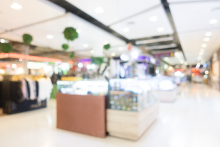 Abstract blur and bokeh shopping mall and department store interior for background
