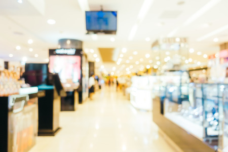Abstract blur and defocused shopping mall center of department store interior for background