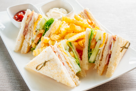 Photo for Club sandwich with bacon cheese and ham vegetable and sauce in white plate - Royalty Free Image
