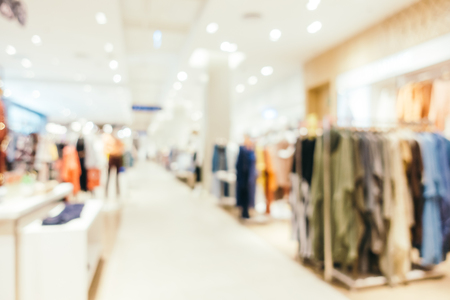 Abstract blur bokeh and defocused shopping mall of department store interior for background