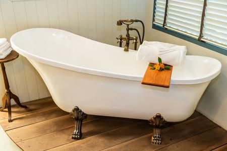 Photo pour Beautiful luxury elegance white bathtub decoration interior of bathroom for spa relax concept - image libre de droit