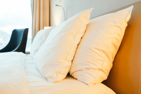 Photo pour White pillow on bed decoration in hotel bedroom interior - image libre de droit