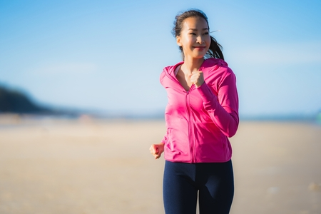 Photo for Portrait beautiful young asian woman running or exercise on the tropica nature landscape of beach sea ocean for healthy concept - Royalty Free Image
