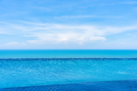 Photo for Beautiful outdoor landscape of infinity swimming pool in hotel resort with sea ocean on white cloud blue sky view for leisure travel in holiday vacation - Royalty Free Image
