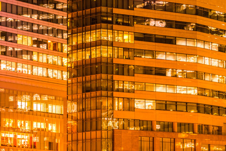 Photo pour Beautiful exterior building and architecture of building with window and light pattern at night - image libre de droit