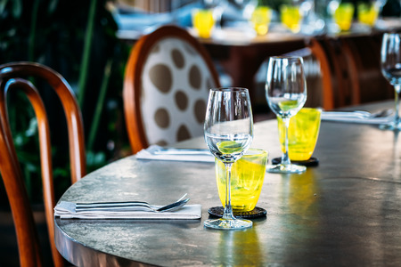 Photo for Wine glass with dining set prepare for breakfast lunch or dinner on table in restaurant and cafe - Royalty Free Image