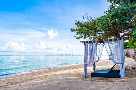 Photo pour Empty bed chair and lounge on the tropical beach sea ocean with white cloud on blue sky for leisure travel and in holiday vacation - image libre de droit