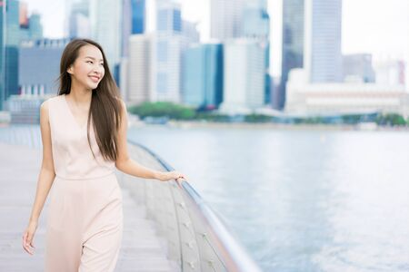 Photo for Beautiful asian woman smile and happy to travel in singapore city - Royalty Free Image