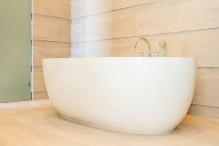 Photo pour Beautiful luxury elegance white bathtub and water faucet decoration in bathroom interior - image libre de droit