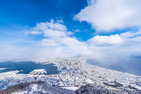 Photo pour Beautiful landscape and cityscape from Mountain Hakodate for look around city skyline building and architecture with blue sky white cloud - image libre de droit