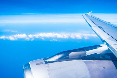 Photo for Aerial view of airplane wing with blue sky and white cloud - Royalty Free Image