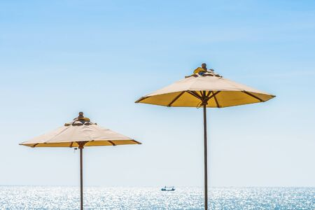 Photo for Beautiful landscape of sea ocean on sky with umbrella and chair around luxury outdoor swimming pool in hotel resort for leisure travel and vacation - Royalty Free Image