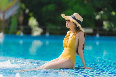 Photo pour Portrait beautiful young asian woman leisure relax smile and happy around swimming pool in hotel resort for holiday vacation trip - image libre de droit