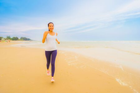 Photo for Portrait beautiful young sport asian woman exercise by run and jogging on the outdoor nature beach and sea for healthy - Royalty Free Image