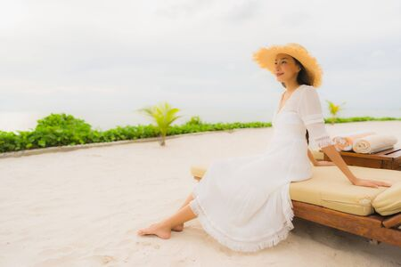 Photo for Portrait beautiful asian woman wear hat with smile happy leisure on the beach and sea ocean in holiday vacation - Royalty Free Image