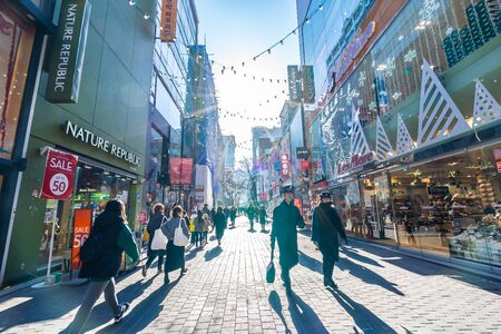 Photo for Seoul, South Korea 10 December 2018 : Myeong dong market is the popular place and district for shopping find something eat and sightseeing - Royalty Free Image
