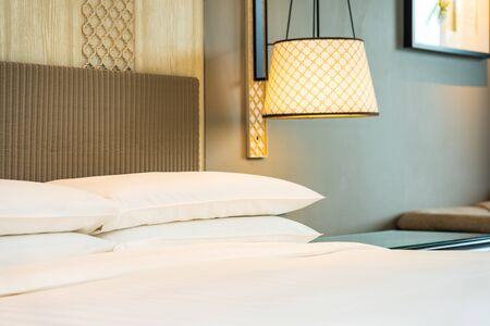 Photo pour White comfortable pillow on bed decoration interior of bedroom - image libre de droit