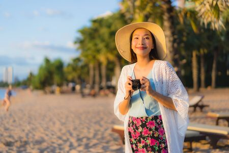 Photo pour Portrait beautiful young asian women happy smile relax around beach sea ocean at sunset or sunrise time for travel vacation - image libre de droit