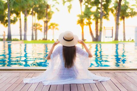 Photo for Portrait beautiful young asian women happy smile relax around outdoor swimming pool in hotel resort at sunset or sunrise time - Royalty Free Image