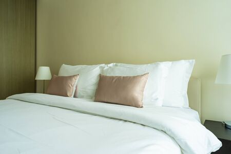 Photo for White comfortable pillow on bed decoration interior of bedroom - Royalty Free Image