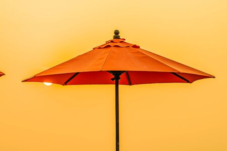Photo for Beautiful sunrise around with umbrella and chair outdoor swimming pool for travel vacation - Royalty Free Image