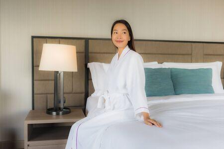 Photo pour Portrait beautiful young asian women smile happy in bedroom interior - image libre de droit