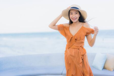 Photo pour Portrait beautiful young asian woman happy smile around sea ocean beach and blue sky for leisure travel vacation - image libre de droit
